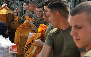 US Navy 111210-N-KS651-659 Sailors and Marines move mail during a replenishment at sea.jpg