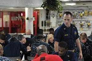 Exam invigilator - An invigilator overseeing an exam in the US Navy