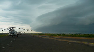 UTair Mil Mi-8s at Jubba as a storm rolls in (1).jpg