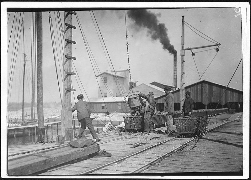 File:Unloading oysters on the dock. Alabama Canning Co. Bayou La Batre, Ala. - NARA - 523399.jpg