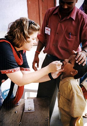 Poliomyelitis eradication - A child receives oral polio vaccine during a 2002 campaign to immunize children in India.