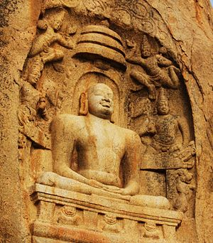 Lotus position - Rock cut sculpture depicting Mahavira in Lotus position at Samanar Hills, Tamil Nadu, India