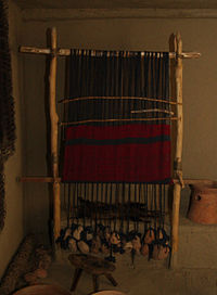 Neolithic warp-weighted loom, a reconstruction.