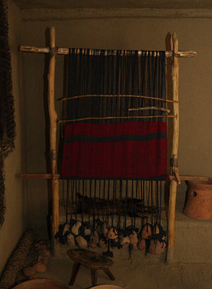 Warp-weighted loom - Reconstruction of a vertical neolithic loom with shed bar without string heddles, on display at Piatra Neamţ Museum