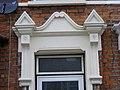 Very fine pedimented doorway moulding. Ilford.jpg