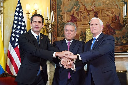 Guaido, Colombia president Duque, and US vice president Pence during the February 2019 Lima Group meeting in Colombia Vice President Mike Pence Travels to Colombia (32269091507).jpg