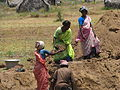 Villagers building a water storage pond 1 (2507498679).jpg