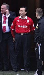 f596e577cae Tan in the rebranded red Cardiff City home kit