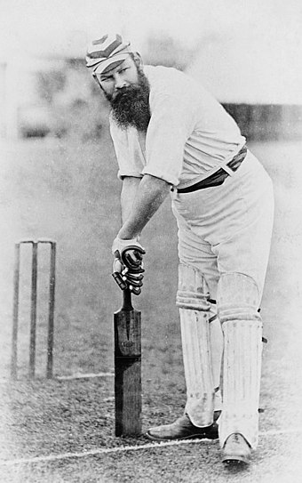 "English cricketer W. G. Grace ""taking guard"" in 1883. His pads and bat are very similar to those used today. The gloves have evolved somewhat. Many modern players use more defensive equipment than was available to Grace, notably helmets and arm guards. WGGrace.jpg"