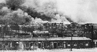 The Holocaust in Poland - Image: Warsaw Gdansk railway station with Warsaw Ghetto burning, 1943