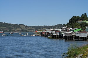 Chilotan architecture - 20th century palafitos, at high tide in Castro, Chile.
