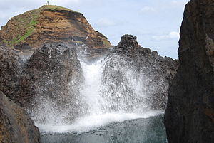 Waves crashing over rocks, Porto Moniz, Madeir...