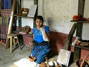 San Juan La Laguna - Tz'utujil women demonstrates traditional weaving techniques