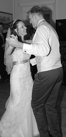 A Bride And Groom Enjoying Their First Dance At Wedding