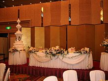 The Wedding Cake And Other Decorations At A Reception In An