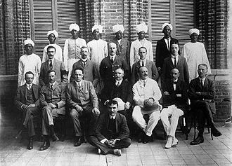 Andrew Balfour - Wellcome Tropical Research Laboratory, Khartoum. Henry Wellcome is sat centrally with white pith helmet on lap; Balfour is to his right.