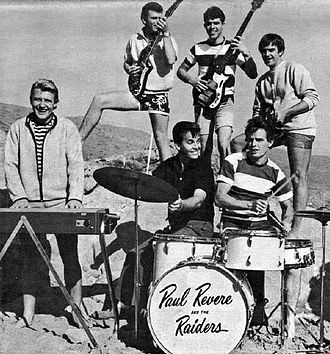 Paul Revere & the Raiders - Where the Action Is photo of Dick Clark with the group in 1966. Front L–R: Paul Revere, Clark and Mike Smith. Back L–R: Drake Levin, Phil Volk and Mark Lindsay.
