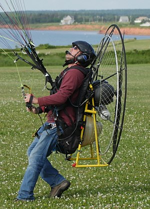 Paramotor - Paramotor showing how seat bottom moves to allow for easy ground handling.