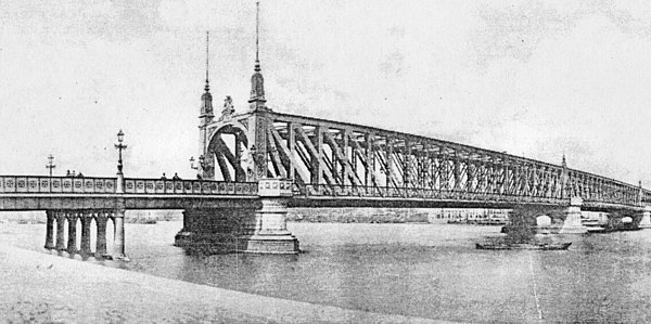 The Willemsbrug shortly after its opening in 1878, as seen from Noordereiland. A new bridge was completed nearby in 1981, and this one was demolished. Willemsbrug 1878.jpg