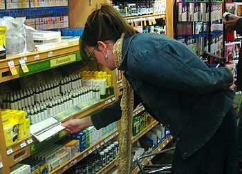 English: Woman looking at Bach Flower remedies...