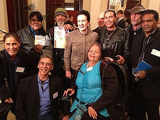Wrong Side of the Road - Wrong Side of the Road cast and crew with Clover Moore, Lord Mayor of Sydney.  Left to right: (crouching) Veronica Brodie, (standing) John Miller, (kneeling) Ken Hampton, (standing, holding photo) Donald (Ducky) Taylor, Lord Mayor, Clover Moore, (in wheelchair) Gayle Rankine, (in black leather jacket) Les Graham, (in hat Peter (Pedro)) Butler, (holding blue folder) Chris Jones aka Ricky Harrison.