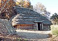 Yaze site reconstructed pit dwelling.jpg