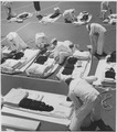 (Practicing packing sea bags, U. S. Naval Training Station, San Diego, California.) - NARA - 295568.tif