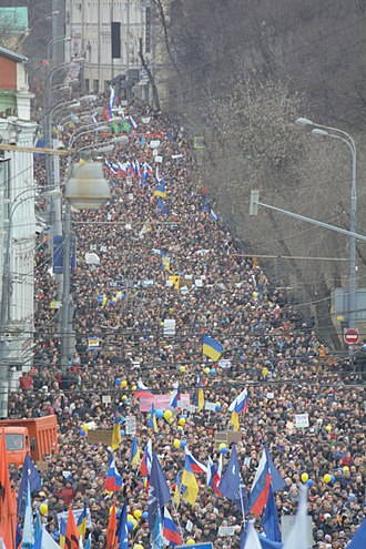2014 anti-war protests in Russia - At least 30,000 people with Russian and Ukrainian flags, flags of political parties and peace symbols.
