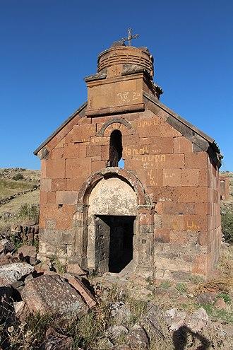 Artavazik Church - Artavazik Church with a large khachkar monument seen behind the church across the ravine.
