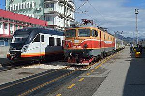 Željeznički prevoz Crne Gore - New CAF Civity next to passenger train hauled by older former JŽ class 461.