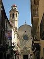 073 Carrer Bisbe Sivilla, al fons l'església.jpg