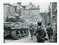 111-SC-211750-1 - Saint-Lô, France. Task force of the 29th Infantry Division meets with heavy artillery fire as it moves down the main streets to clean up what is left of the city.jpg