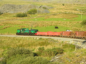 Welsh Highland Railway restoration - SAR NGG 16 Class Garratt 138 'Mileniwm'/'Millennium' hauls a mixed goods and passenger train away from Rhyd Ddu during the 2006 'Superpower' weekend.