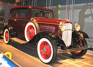 1932 Ford - 1932 Ford V-8 Standard Tudor Model 18 with optional color keyed wheels, white wall tires, and side mounts