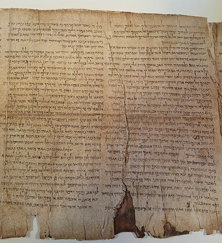 "While in Jericho, Origen bought an ancient manuscript of the Hebrew Bible which had been discovered ""in a jar"", a discovery which prefigures the later discovery of the Dead Sea Scrolls in the twentieth century. Shown here is a section of the Isaiah scroll from Qumran. 1 QIsa example of damage col 12-13.jpg"