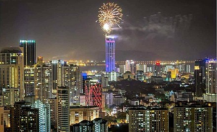 The 68-storey Komtar Tower (centre) in George Town also houses the Office of the Chief Minister of Penang. 2018 New Year Fireworks in George Town, Penang.jpg