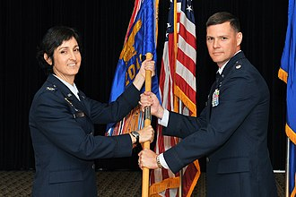 20th Intelligence Squadron - Col Carol Northrup, Air Force Targeting Center commander, passes the squadron guidon to incoming commander, Lt Col Patrick Sutherland
