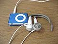 2G iPod Shuffle blue with headphones.jpg