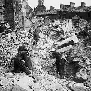 Belfast Blitz - Rescue workers searching through rubble after an air raid on Belfast
