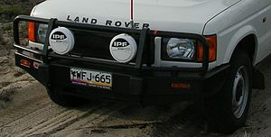 Bullbar - A bullbar on a Land Rover Discovery fitted with spotlights and a sand flag.