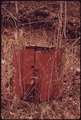 A LOCK IS STILL ON THE DOOR OF THIS STRUCTURE WHICH WAS USED TO HOLD EXPLOSIVES FOR A MINE NEAR RICHLANDS, VIRGINIA... - NARA - 556354.tif