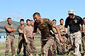 A Mongolian service member runs through a pepper spray qualification course during Non-Lethal Weapons Executive Seminar (NOLES) 13 at Five Hills Training Area, Mongolia, Aug. 21, 2013 130821-M-DR618-153.jpg