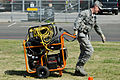 A U.S. Airman assigned to the California Air National Guard's Homeland Response Force (HRF) pulls a generator during an emergency response training exercise at Naval Amphibious Base Coronado, Calif., May 24 130524-Z-UP142-123.jpg