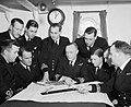 A captains conference of the Harwich minesweeping Flotilla, where officers discuss plans to sweep an area clean of mines, 16 May 1942. A10438.jpg