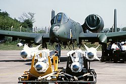 A front view of an A-10 Thunderbolt II aircraft being uploaded with AGM-65 Maverick missiles.JPEG