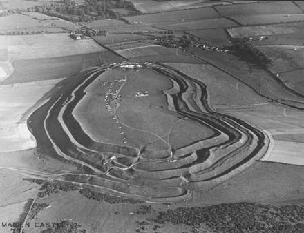 Mortimer Wheeler pioneered systematic excavation in the early 20th century. Pictured, are his excavations at Maiden Castle, Dorset, in October 1937. Aerial photograph of Maiden Castle from the west, 1937.jpg