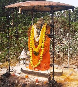 Suruli Falls - Idol of Agasthya Muni at the top of Agasthyamalai peak
