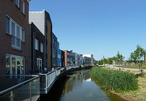 """N. John Habraken - 2012, Almere Homeruskwartier, """"Mix of styles"""". Master plan and coordination OMA, design of houses by different architects and residents. Further illustrations see below"""