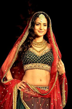 Midriff - Indian actor Amisha Patel posing in a Gagra choli that bares the midriff