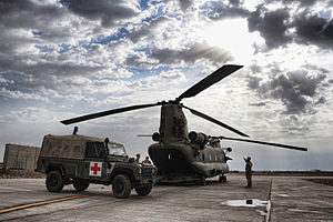 Camp Shorabak - An ambulance waits to receive a casualty from a Chinook on the helipad.